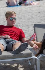 CLAUDIA ROMANI and Chris Johns at a Beach in Miami 02/07/2018
