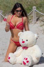 CLAUDIA ROMANI in Bikini Gets Ready for Valentine