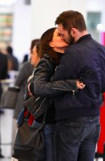 COURTENEY COX and Johnny McDaid at Heathrow Airport in London 02/17/2018