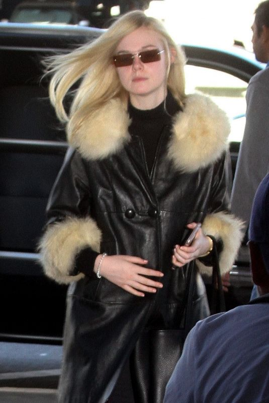 ELLE FANNING Arrives at LAX Airport in Los Angeles 02/13/2018