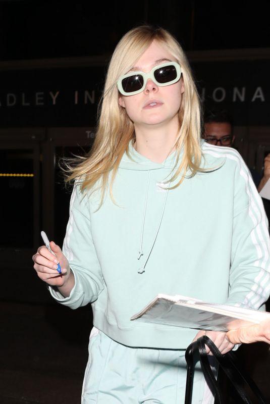 ELLE FANNING at Los Angeles International Airport 02/21/2018
