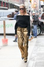 HAILEY BALDWIN in a Gold Pants Out in New York 02/09/2018