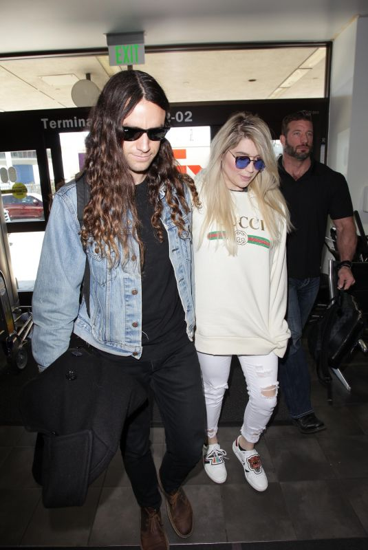 KESHA SEBERT and Brad Ashenfelter at LAX Airport in Los Angeles 02/19/2018