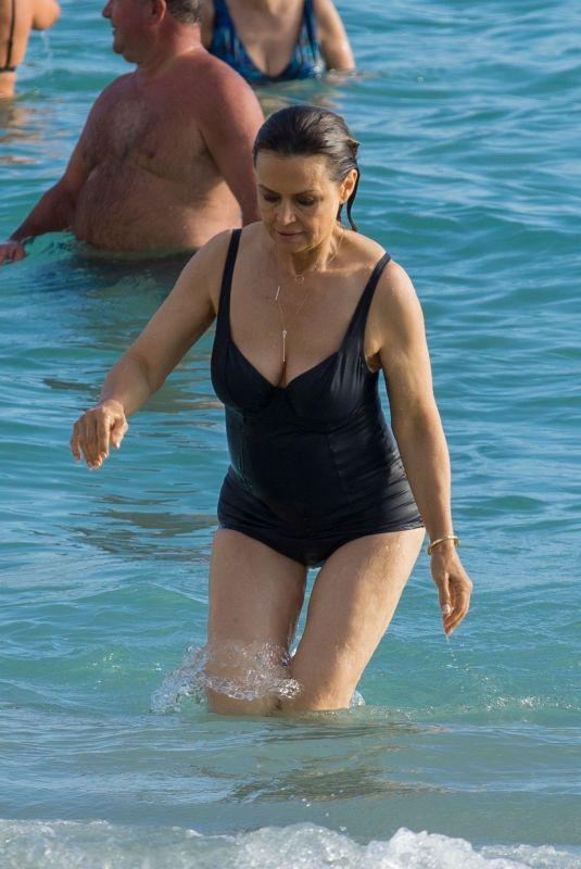 LISA WILKINSON in Swimsuit at a Beach in Waikiki 01/19/2018