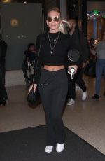 LOUISA JOHNSON at LAX Airport in Los Angeles 02/16/2018