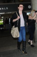 MILLA JOVOVICH at Los Angeles International Airport 02/08/2018