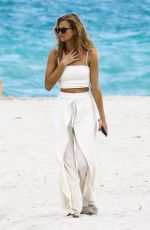 NADINE LEOPOLD in Bikinis at a Photoshoot on the Beach in Miami 02/06/2018