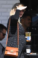 Pregnant KIRSTEN DUNST at McConnell