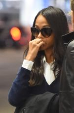 ZOE SALDANA and Marco Perego at LAX Airport in Los Angeles 02/01/2018