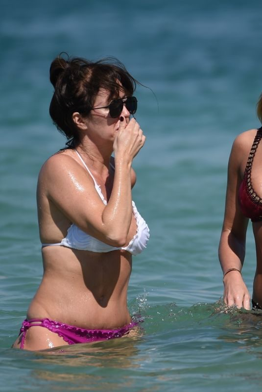 ALEX CURRAN and SHEREE MURPHY in Bikinis at a Beach in Dubai 03/16/2018