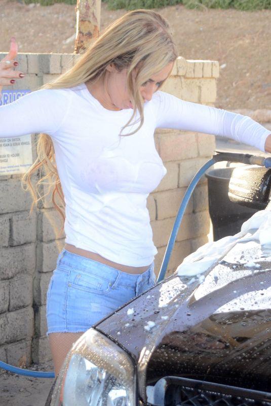 ANA BRAGA Washing Her Car in Calabasas 03/18/2018