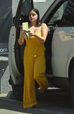 ARIEL WINTER in Yellow Jumpsuit at a Studio in Los Angeles 03/29/2018