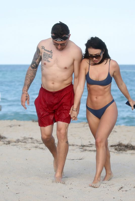 BRE TIESI in Bikini and Johnny Manziel at a Beach in Miami 03/01/2018