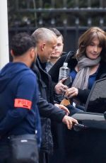 CARLA BRUNI-SARKOZY Leaves Her Home in Paris 03/23/2018