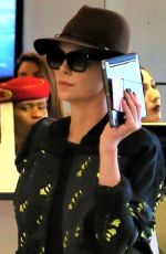 CHARLIZE THERON at Los Angeles International Airport 03/15/2018