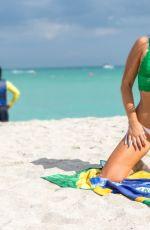 CLAUDIA ROMANI Celebrates Saint Patricks Day at a Beach in Miami 03/17/2018