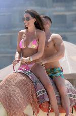 DANIELLE LLOYD in Bikini Riding a Camel on the Beach in Dubai 03/30/2018