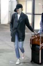 EMMA STONE at Heathrow Airport in London 03/26/2018