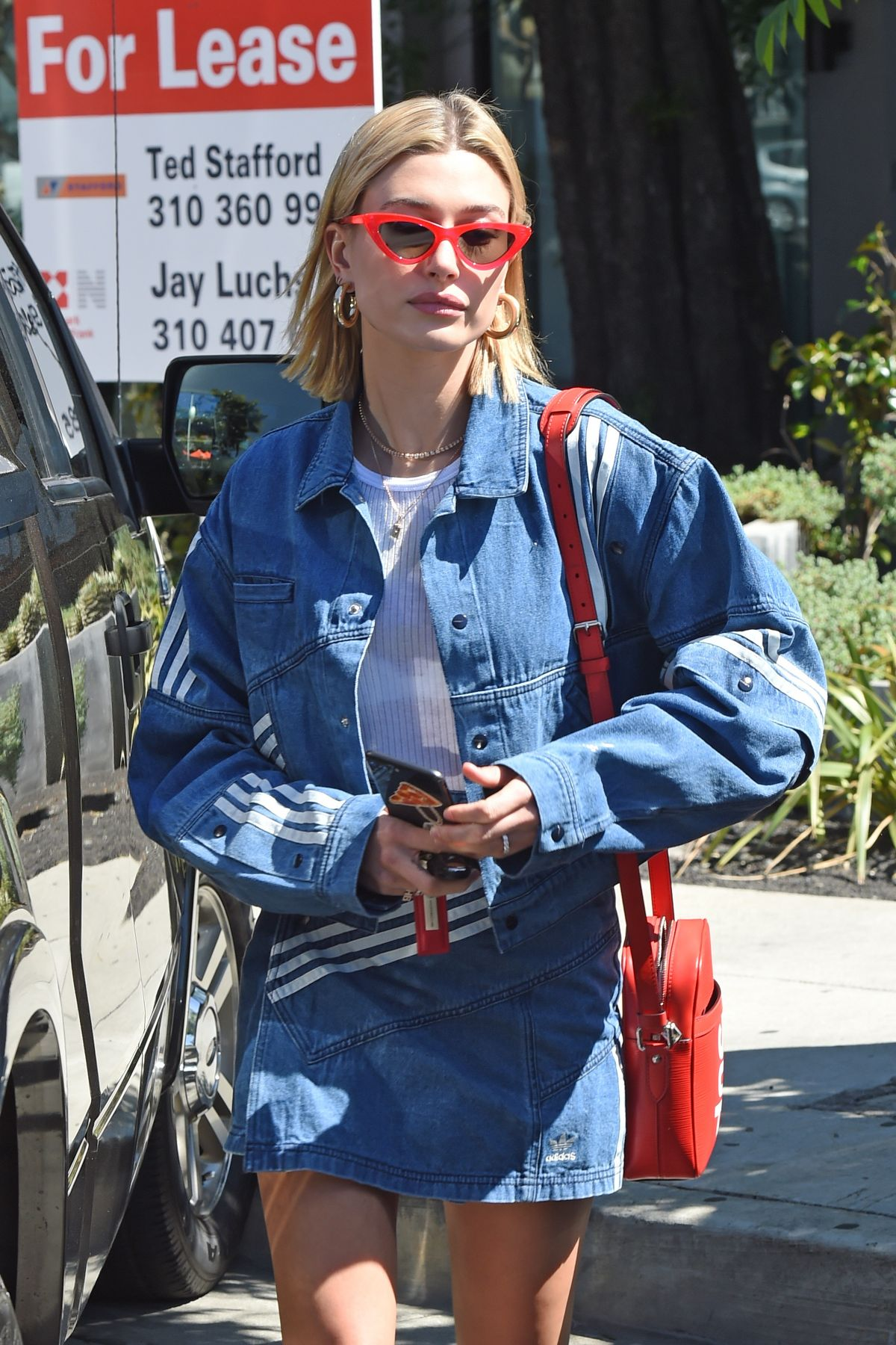63adfa680 HAILEY BALDWIN in Adidas Denim Skirt at Zinque Cafe in West Hollywood 03/26/