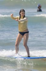 KIRA KOSARIN in Bikini Out Surfing in Maui 03/27/2018