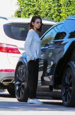 MILA KUNIS Returns to Her Tesla Model 3 Car in Los Angeles 03/27/2018