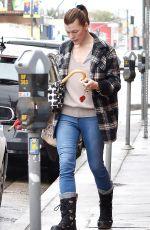 MILLA JOVOVICH Leaves a Wax Salon in Los Angeles 03/22/2018