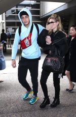 NICOLA PELTZ and Anwar Hadid at LAX Airport in Los Angeles 03/07/2018