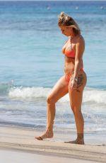 OLIVIA BUCKLAND in a Orange Bikini at a Beach in Barbados 03/13/2018