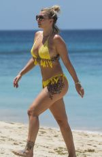 OLIVIA BUCKLAND in Bikini on Vacation in Barbados 03/20/2018