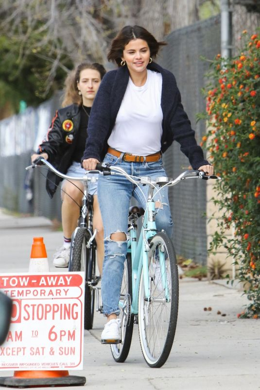 SELENA GOMEZ Riding a Bike Out in Studio City 03/16/2018
