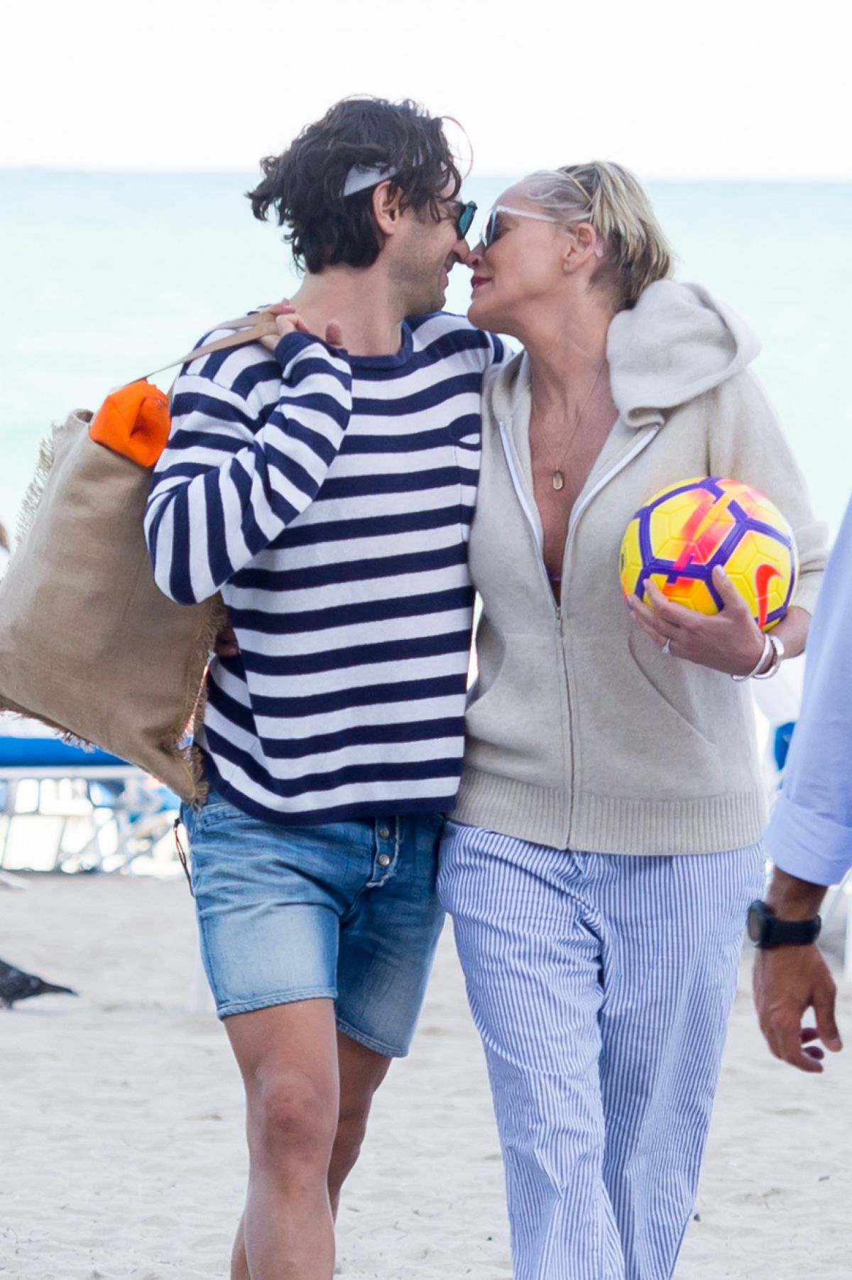 SHARON STONE and Angelo Boffa on the Beach in Miami 03/09