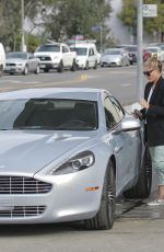 SOPHIA THOMALLA at a Gas Station with Her Aston Martin in Los Angeles 03/20/2018