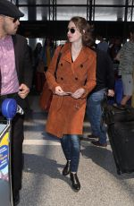 ALISON BRIE at LAX Airport in Los Angeles 04/16/2018