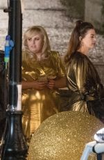 ANNE HATHAWAY and REBEL WILSON on the Set of THe Hustle in London 04/12/2018