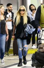CARMEN ELECTRA Arrives at Airport in Miami 04/13/2018