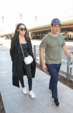 CHLOE BRIDGES and Adam Devine at LAX Airport in Los Angeles 04/20/2018
