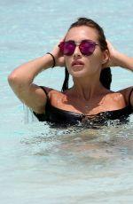 CHLOE GOODMAN in Bikini on the Beach in Dubai 04/03/2018