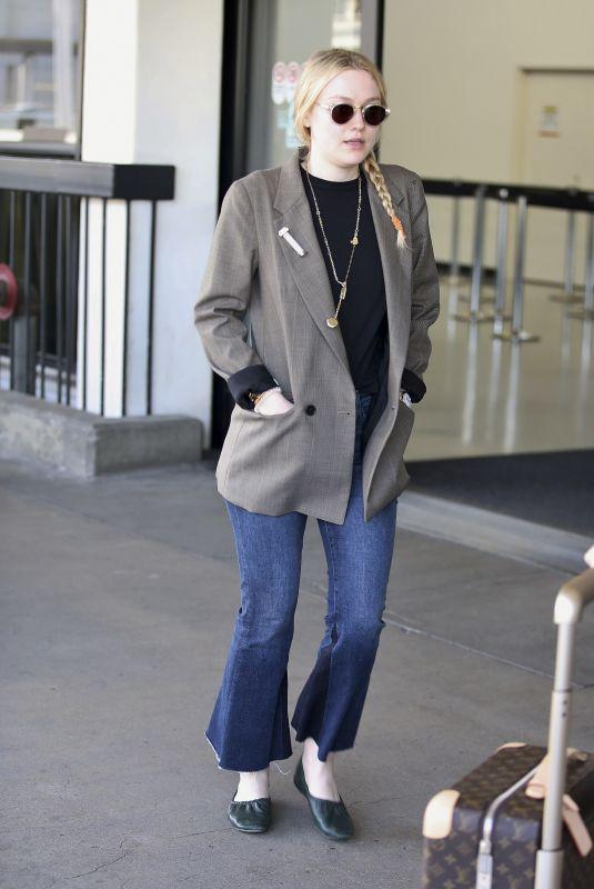 DAKOTA FANNING at LAX Airport in Los Angeles 04/17/2018