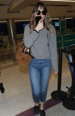 DAKOTA JOHNSON Arrives at LAX Airport in Los Angeles 04/03/2018