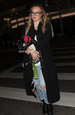 HILARY DUFF with Her Dog at LAX Airport in Los Angeles 04/12/2018