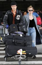LILI REINHART and Cole Sprouse  at LAX Airport in Los Angeles 04/04/2018