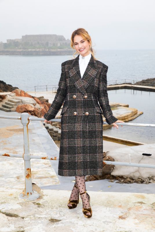 LILY JAMES at The Guernsey Literary and Potato Peel Pie Society Photocall in Guernsey 04/12/2018