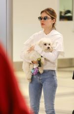 LUCY HALE with Her Dog at LAX Airport in Los Angeles 04/02/2018