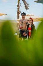 MADELAINE PETSCH and Travis Mills at a Beach in Cancun 04/18/2018