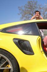 MARIA SHARAPOVA and Mark Webber Driving Porsche 911 RT2 RS in Stuttgart 04/20/2018