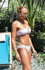 MELANIE BROWN in Bikini at a Pool in Palm Springs 04/10/2018
