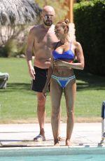 MELANIE BROWN in Bikini at a Pool in Palm Springs 04/15/2018