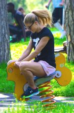 MICHELLE HUNZIKER at a Park in Bergamo 04/28/2018