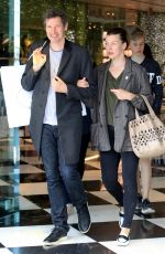 MILLA JOVOVICH and Paul W. S. Anderson Shopping at Prada Store in Beverly Hills 04/02/2018