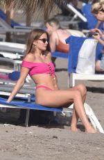 MILLIE MACKINTOSH in Bikini on the Beach in Marbella 04/24/2018